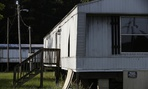 In this photo taken July 14, 2017, abandoned mobile homes are seen near Windsor, N.C., located in Bertie County.
