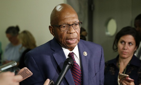Rep. Elijah Cummings, D-Md., speaks with reporters in June. Cummings wrote a letter to HHS and CMS demanding information on the removal of Obamacare sections on agency websites.