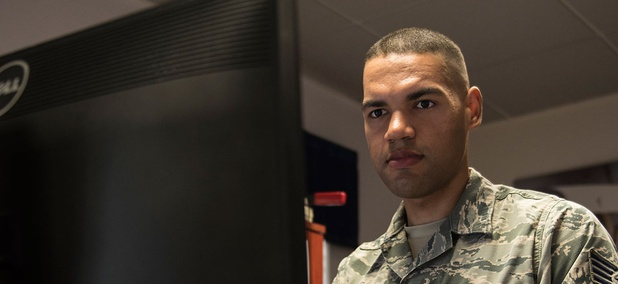 Air Force Staff Sgt. Bryant Lopez-Cepero, 728th Air Mobility Squadron unit training manager, works at his computer at Incirlik Air Base in Turkey in July.