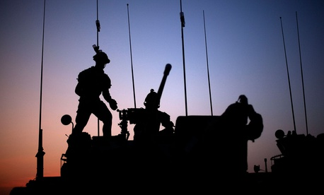 Soldiers with the Canadian Army's 1st Battalion 22nd Royal Regiment prepare for an operation at sunrise Monday, June 27, 2011 on Forward Operating Base Sperwan Ghar in the Panjwaii district of Kandahar province, Afghanistan