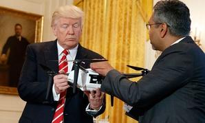 Trump examines a drone in 2017.
