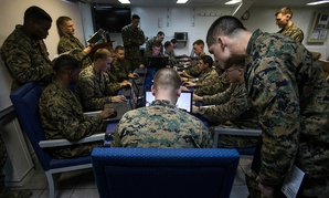U.S. Marines assigned to Battalion Landing Team, 2nd Battalion, 6th Marine Regiment (BLT 2/6), 26th Marine Expeditionary Unit (MEU), conduct simulated squad-level integrated training with Virtual Battlespace Simulator.