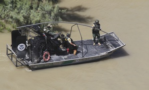 A Border Patrol Riverine Unit conducts patrols in an Air and Marine Air-Boat in South Texas, Laredo, along the Rio Grande Valley river in 2013.