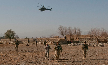 "A U.S. Army OH-58 Kiowa Helicopter flies low over 2nd Platoon, Company B, 3rd Battalion, 187th Infantry Regiment, 3rd Brigade ""Rakkasans,"" 101st Airborne Division (Air Assault), during a patrol in Khowst Province, Afghanistan, Jan. 13, 2013."