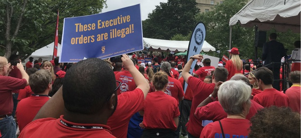 Federal workers protest President Trump's executive orders curbing civil service protections in Washington prior to a federal court hearing July 25.