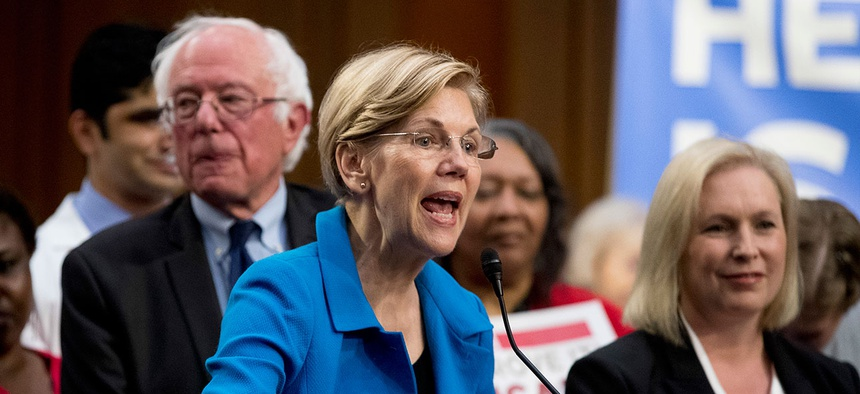 Sen. Elizabeth Warren, D-Mass., center, accompanied by Sen. Bernie Sanders, I-Vt., left, and Sen. Kirsten Gillibrand, D-N.Y., right, speaks during a news conference on Capitol Hill  Wednesday, Sept. 13, 2017, to unveil their Medicare for All legislation.