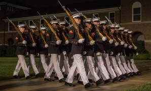 Marines with Alpha Company, Marine Barracks Washington D.C., march during a Friday evening parade in early August.