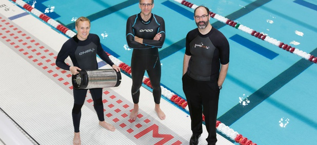 From left, graduate student Anton Cottrill, Dr. Jacopo Buongiorno and Dr. Michael Strano try out neoprene wetsuits at MIT's athletic center.