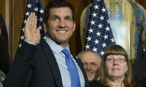 Rep. Scott Taylor, R-Va., takes the oath of office. Taylor is organizing the letter opposing the pay freeze.