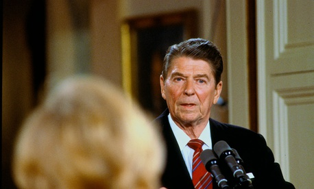 On May 22, 1984, then-President Ronald Reagan answers reporter's question during news conference in the East Room of the White House.