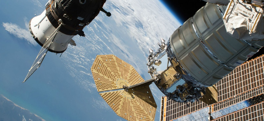 The Russian Soyuz MS-09 crew craft and the Northrop Grumman (formerly Orbital ATK) Cygnus space freighter, attached to the International Space Station.