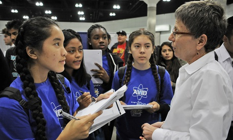 A group of students speak with Karen Austin of the Space and Missile Systems Center of Los Angeles Air Force Base in 2015.