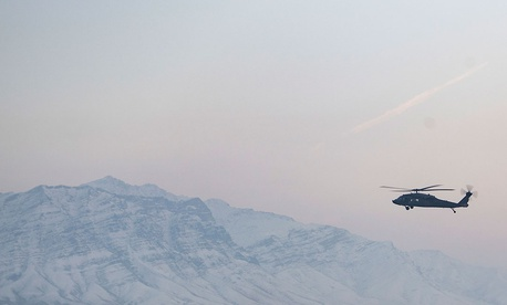 A helicopter flies over Bagram Air Field, Afghanistan, Jan. 30, 2018.