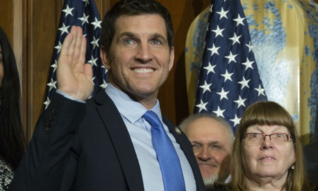 Rep. Scott Taylor, R-Va., takes the oath of office. Taylor introduced the legislation.