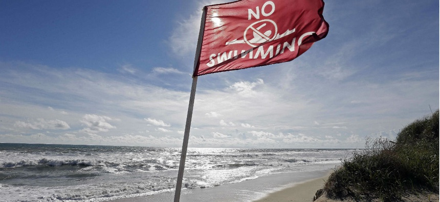 A flag warns against swimming in Nags Head, N.C., as Hurricane Florence approaches.