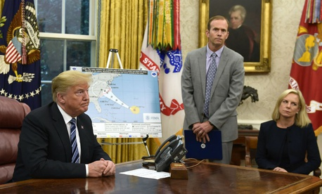 Reporters question FEMA Administrator Brock Long (center) during a briefing on Hurricane Florence Tuesday.