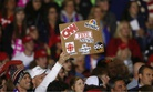 An audience member holds a fake news sign during a President Donald Trump campaign rally in Michigan on April 28.