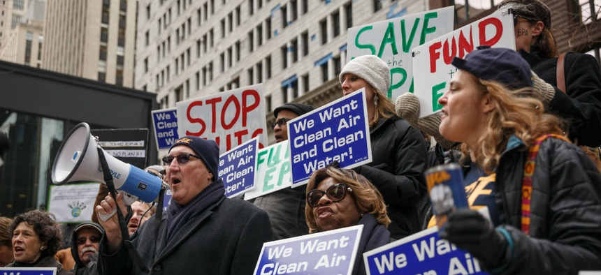 EPA employees protest job cuts at the agency in March 2017. The Trump administration has tried to curtail the role of federal unions.