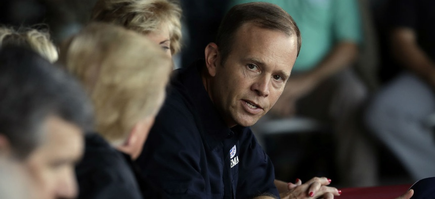 FEMA Administrator Brock Long (right) attends a briefing after visiting areas impacted by Hurricane Florence last week.