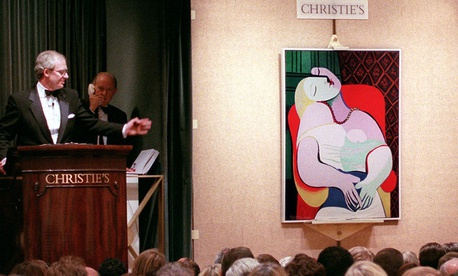 "Picasso's ""The Dream"" is auctioned by auctioneer Christopher Burge at Christie's auction house in New York in 1997."