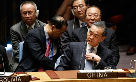 Chinese Foreign Minister Wang Yi listens during a UN Security Council session chaired by Donald Trump.