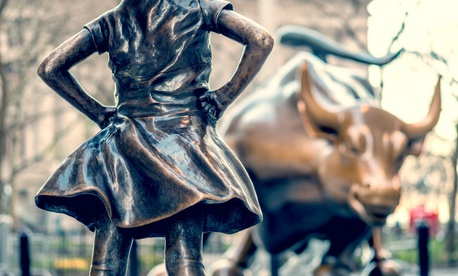 """The Fearless Girl"" statue facing Charging Bull in Lower Manhattan, New York City."