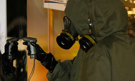 A Hazmat crew checks a stain on the wall at Kuala Lumpur International Airport 2 in Sepang, Malaysia in 2017.