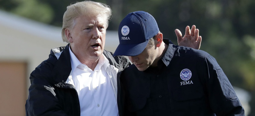 FEMA Administrator Brock Long (right) speaks with President Trump after visiting areas in North Carolina and South Carolina affected by Hurricane Florence.