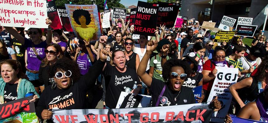 Demonstrators protest against Supreme Court nominee Brett Kavanaugh on Thursday.