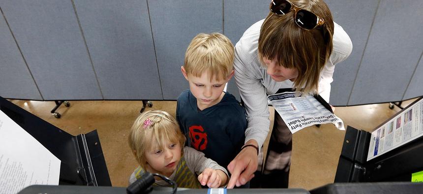 Liv Gjestvang, right, has her kids Solveig Applegate, left, and Karsten Applegate help with voting in Ohio in 2016.