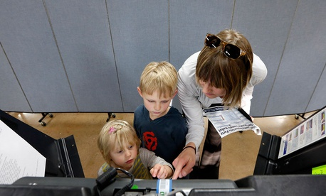 Liv Gjestvang, right, has her kids Solveig Applegate, left, and Karsten Applegate help with voting in Ohio in 2016.