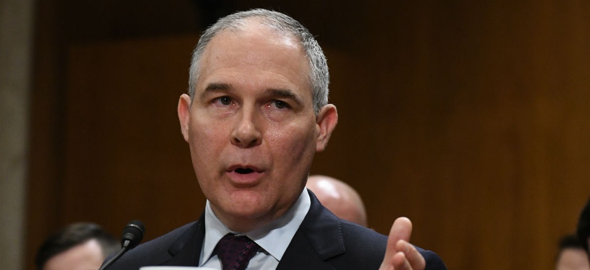 Former EPA administrator Scott Pruitt testifies at his confirmation hearing.