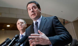 House Intelligence Committee Chairman Rep. Devin Nunes, R-Calif., right, accompanied by the committee's ranking member, Rep. Adam Schiff, D-Calif., talks to reporters, on Capitol Hill in 2017.