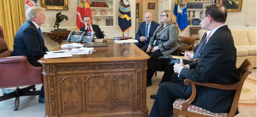 President Trump meets with GSA Administrator Emily Murphy and other administration officials on Jan. 24.