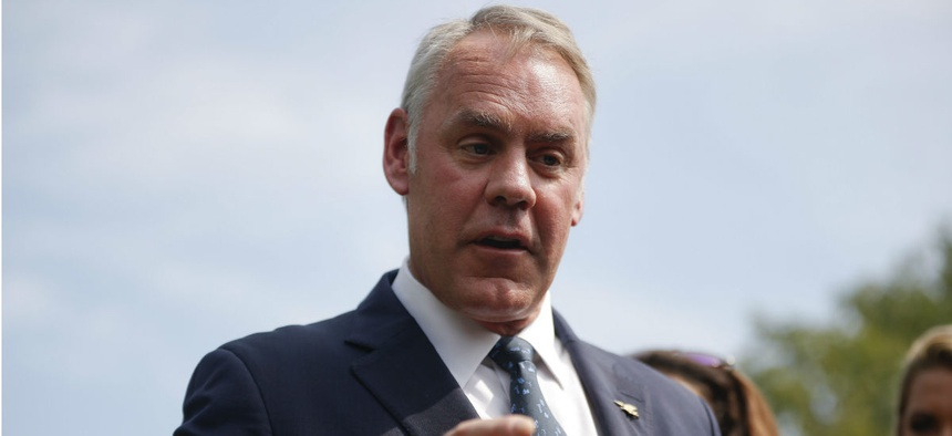 Interior Secretary Ryan Zinke speaks to the press outside the White House in August.