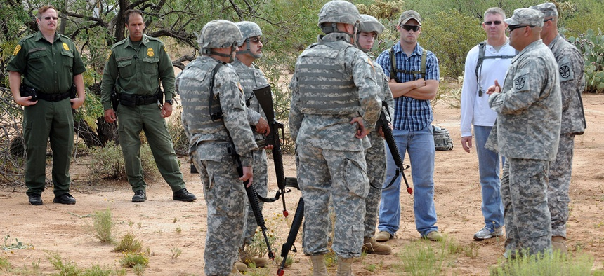 Border Patrol agents observe Arizona National Guard Soldiers training in Arizona in 2010.