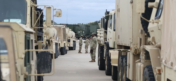 Soldiers prepare their vehicles on Oct. 31 to roll out from Fort Hood to the border.