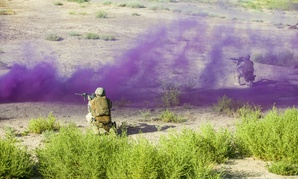 Combined forces participate in a live fire exercise at Camp Taji, Iraq, in August.