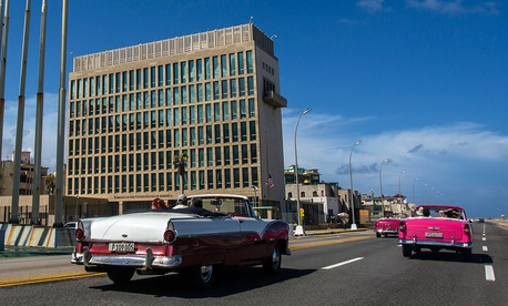 Tourists ride classic convertible cars on the Malecon beside the United States Embassy in Havana in 2017.