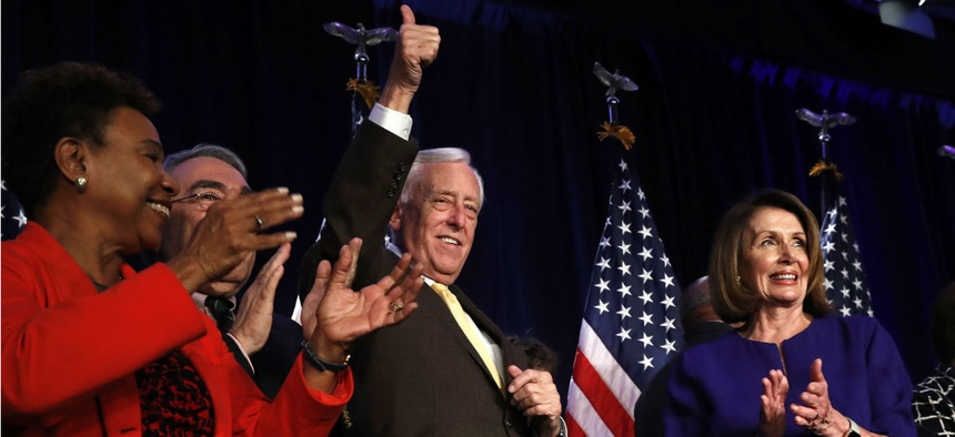 House Minority Leader Nancy Pelosi of Calif., right, celebrates midterm election returns as House Minority Whip Steny Hoyer, D-Md., makes the thumbs up sign. Also pictured: Rep. Barbara Lee, D-Calif., and Rep. G.K. Butterfield, D-N.C., chair of the Congre