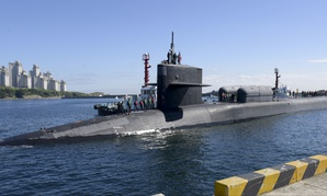 The Ohio-class guided-missile submarine USS Michigan (SSGN 727) (Gold) pulls into the pier of Republic of Korea's Busan Naval Base as part of a routine port visit.