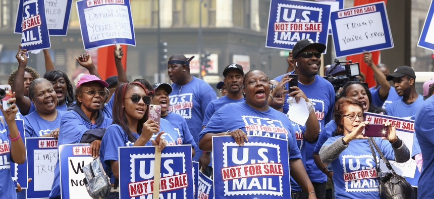 Postal workers and their supporters rally in Chicago on Oct. 8, 2018, to protest a proposal announced in June by the White House to privatize the U.S. Postal Service.