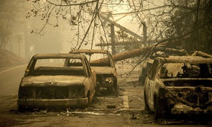 Abandoned cars, scorched by the wildfire, line Pearson Rd. in Paradise, Calif., on Saturday, Nov. 10, 2018.