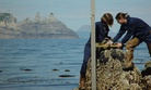 NOAA employees install a tide gauge near Castle Cape, Alaska.