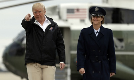 President Trump walks from Marine One helicopter to board Air Force One for a trip to visit areas impacted by the California wildfires on Nov. 17.