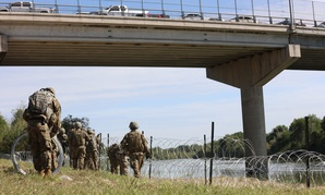 Soldiers deploy concertina wire in a location along the Southwest border on Nov. 2.