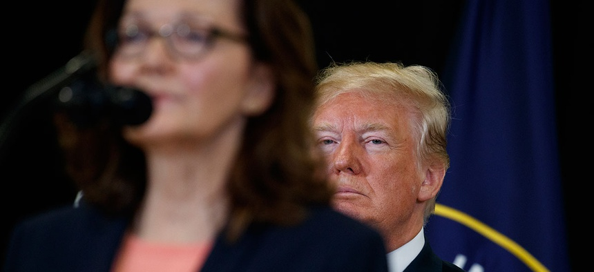 President Donald Trump listens as incoming Central Intelligence Agency director Gina Haspel speaks during a swearing-in ceremony at CIA Headquarters in May.