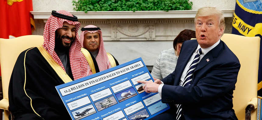 President Donald Trump shows a chart highlighting arms sales to Saudi Arabia during a meeting with Saudi Crown Prince Mohammed bin Salman in the Oval Office in March.