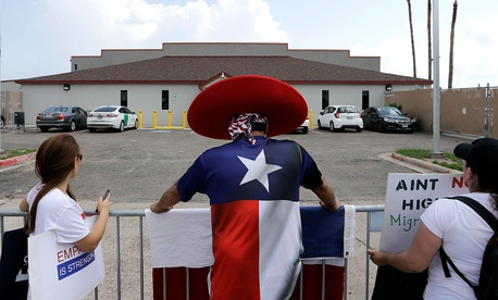 Demonstrators stand outside the U.S. Border Patrol Central Processing Center during a protest in June in Texas.