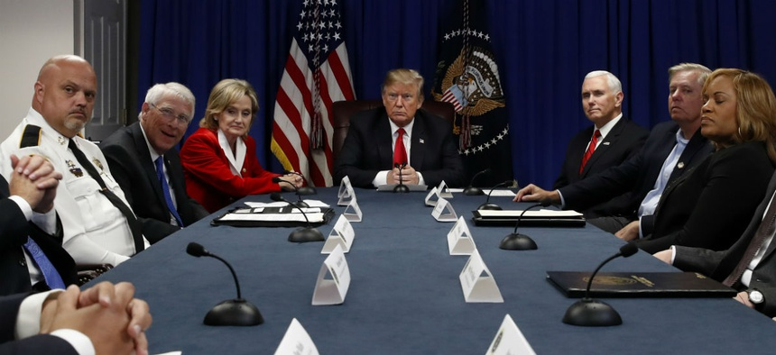 President Trump speaks Monday during a roundtable discussion in Mississippi on the First Step Act.